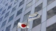 Panasonic Corp's flag and Japan's national flag wave in the wind at its Tokyo office July 9, 2012. (KIM KYUNG-HOON/REUTERS)