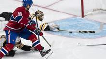 Montreal Canadiens' Lars Eller scores on Boston Bruins goalie Tuukka Rask during first period NHL playoff hockey action on May 12 in Montreal. (Paul Chiasson/THE CANADIAN PRESS)
