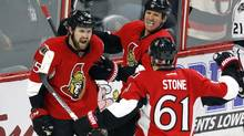 Ottawa Senators forward Zack Smith (15) celebrates his goal against the Los Angeles Kings with teammates Mark Stone (61) and Marc Methot (3) on Nov. 11, 2016. (Fred Chartrand/The Canadian Press)