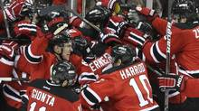 The New Jersey Devils celebrate after beating the New York Rangers 3-2 in overtime in Game 6 of the NHL hockey Stanley Cup Eastern Conference finals Friday, May 25, 2012, in Newark, N.J. The Devils advanced to the Stanley Cup finals. (Frank Franklin II/Frank Franklin II/AP)