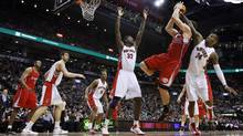 Toronto Raptors Sonny Weems and Ed Davis guard Los Angeles Clippers Blake Griffin during the second half of their NBA basketball game in Toronto. (MARK BLINCH/Reuters)