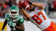 B.C. Lions' Marco Iannuzzi, right, hauls in a pass as Saskatchewan Roughriders' Nick Graham defends during the first half of a pre-season CFL football game in Vancouver, B.C., on June 22, 2011. (The Canadian Press)