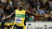 Jamaica's Usain Bolt celebrates after winning the men's 4x100 relay final at the World Athletics Championships in Daegu, South Korea, Sept. 4, 2011. (Lee Jin-man/Lee Jin-man/AP)