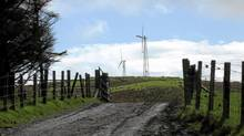 While a large turbine can generate energy for 5,000 homes, smaller windmills provide energy for a single household or farm, like this one in Isle of Luing, Scotland. (Handout/Handout)