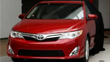 The 2012 Toyota Camry is unveiled during a news conference in Dearborn, Mich., Tuesday, Aug. 23, 2011. (Paul Sancya/AP Photo/Paul Sancya)