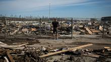 A resident looks over the damage in the Timberlea neighbourhood in Fort McMurray, Alta., on June 2, 2016. (TOPHER SEGUIN/REUTERS)
