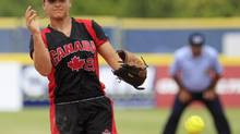 Canada's Jenna Caira pitches against Netherlands in the first inning of the third place World Cup of Softball game in Oklahoma City, Monday, July 2, 2012. (Sue Ogrocki/AP)