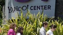 People walk past Yahoo! offices in Santa Monica, California, May 19, 2008. (LUCY NICHOLSON/REUTERS)