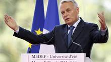 France's Prime Minister Jean-Marc Ayrault delivers his speech at the French employers' MEDEF union summer forum in Jouy-en-Josas, near Paris, Aug. 29, 2012. (CHARLES PLATIAU/REUTERS)