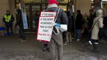 Ontario teachers and their supporters protested outside Maple Leaf Gardens, where the Ontario Liberal leadership convention was underway in January. (Peter Power/The Globe and Mail)