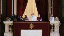 Pope Francis waves to the crowd from the central balcony of St. Peter's Basilica at the Vatican shortly after his election as leader of the Roman Catholic Church on March 13, 2013. (Michael Sohn/AP)