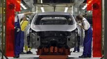 Workers assemble Kia cars in its factory in Zilina, 200 kilometres north of Bratislava, in a file photo. (PETR JOSEK/REUTERS)