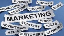 Marketing Concept Torn Newspaper Headlines Reading Marketing, Strategy, Branding, Advertising Etc (Brian Jackson/Photos.com)
