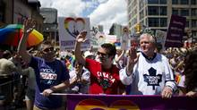 Toronto Maple Leafs General Manager, Brian Burke and comedian Rick Mercer march during the Gay Pride parade in Toronto July 1, 2012. (MARK BLINCH/REUTERS)