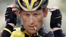 In this Feb. 22, 2009 file photo, Lance Armstrong prepares for the final stage of the Tour of California cycling race in Rancho Bernardo, Calif. (Marcio Jose Sanchez/AP)