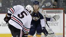 Nashville Predators center Colin Wilson, right, gets set to try to block a shot by Chicago Blackhawks defenseman Brent Sopel (5) in the first period of a first-round NHL Western Conference hockey playoff game on Tuesday, April 20, 2010, in Nashville, Tenn. (Mark Humphrey/AP)
