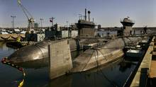 The Victoria-class submarines HMCS Chicoutimi, right, HMCS Windsor, left, and HMCS Corner Brook, back right, rest at berth in Halifax in this photo from 2005. (ANDREW VAUGHAN/Canadian Press)