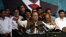 Nawaz Sharif (C), incoming prime minister and leader of the Pakistan Muslim League-Nawaz (PML-N) political party, speaks to his party members who were voted to political posts in the general election, in Lahore May 20, 2013. (MOHSIN RAZA/REUTERS)