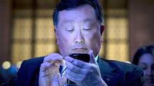 BlackBerry Chief Executive John Chen attends the launch event for the new Blackberry Classic smartphone in New York, December 17, 2014. (BRENDAN MCDERMID/REUTERS)