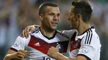 Germany's Lukas Podolski (L) and Miroslav Klose celebrate Podolski's goal during their friendly soccer match against Armenia in Mainz June 6, 2014. (Reuters)