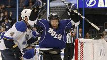 Tampa Bay Lightning's Dominic Moore celebrates his second period goal in front of St. Louis Blues' Eric Brewer (4) and goalie Ty Conklin inan NHL hockey game Sunday, Feb. 6, 2011, in Tampa, Fla. The Lightning won 4-3. (AP Photo/Mike Carlson) (Mike Carlson)