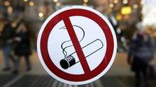 A sticker with a no smoking sign adorns the glass door of a Berlin shopping mall 31 January 2008. (JOHN MACDOUGALL/JOHN MACDOUGALL/AFP-Getty Images)