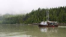 A commercial fishing boat passes the site of the proposed Enbridge Northern Gateway bitumen terminal on Douglas Channel, south of Kitimat, B.C. (Robin Rowland/The Canadian Press)