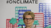 Ontario Premier Kathleen Wynne listens to questions from the media during an announcement which outlined a cap and trade deal with Quebec aimed at curbing green house emissions, in Toronto on April 13, 2015. (Chris Young/THE CANADIAN PRESS)