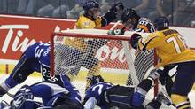 Shawinigan Cataractes Michael Bournival, right, and Anton Zlobin celebrate their first goal as Saint John Sea Dogs goalie Mathieu Corbeil and Kevin Gagne dive into the net during second period Memorial Cup action in Shawinigan Que., on Wednesday, May 23, 2012. (Jacques Boissinot/CP/Jacques Boissinot/CP)