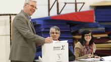 Manitoba Premier Greg Selinger casts his ballot in the Manitoba election in Winnipeg, Tuesday, October 4, 2011. (THE CANADIAN PRESS / John Woods/THE CANADIAN PRESS / John Woods)