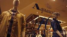 Apparel is displayed at an Aquascutum store in Hong Kong in a file photo. Chinese clothing giant Bosideng recently opened a store in London, where it hopes to compete with other high-end clothing brands. (BOBBY YIP/REUTERS)