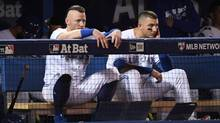 Josh Donaldson, left, and Troy Tulowitzki watch from the dugout during the ninth inning in game three of the 2016 ALCS playoff baseball series against the Cleveland Indians at Rogers Centre. (Nick Turchiaro/USA TODAY)