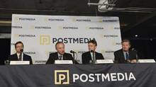 Postmedia Executive Vice President and Chief Financial Officer Doug Lamb, left, President and CEO Paul Godfrey, Chair of Postmedia Board of Directors Rod Phillips, and COO Wayne Parrish attend a press conference in Toronto Monday, Oct. 6, 2014 announcing Postmedia's purchase of Sun Media Corp.'s English-language operations. (Hannah Yoon/THE CANADIAN PRESS)