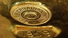 The emblem of Canadian Royal Mint is pictured on a gold bar at Deutsche Bundesbank during a news conference in Frankfurt January 16, 2013. (Lisi Niesner/Reuters)