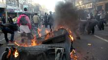 A garbage container is set on fire as Iranian protesters stage an anti-government demonstration, under the pretext of rallies supporting Arab uprisings, in Tehran on February 14, 2011. (-/AFP/Getty Images)