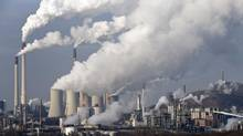 In this Wednesday, Dec. 16, 2009 file photo, steam and smoke rises from a coal burning power plant in Gelsenkirchen, Germany. (Martin Meissner/AP)