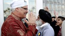 British Columbia Premier Gordon Campbell, left, greets people while attending the Vaisakhi parade in Vancouver, B.C., on Saturday April 10, 2010. (Darryl Dyck/ The Canadian Press/Darryl Dyck/ The Canadian Press)