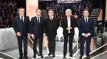 (Left to right) French presidential election candidates: Francois Fillon, Emmanuel Macron, Jean-Luc Melenchon, Marine Le Pen and Benoit Hamon, pose before a debate organized by the French private TV channel TF1 on March 20, 2017 in Aubervilliers. (ELIOT BLONDET/AFP/Getty Images)