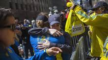 Runners embrace in Boston on Tuesday after picking up their medals near the finish line of the Boston Marathon, the site of a deadly pair of bombings a day earlier. Runners embrace after picking up their medals near the finish line of the Boston Marathon, a day after the race in Boston, Massachusetts on April 16, 2013. Officials investigating the Boston Marathon bombing said on Tuesday that no additional explosive devices have been discovered other than the two that detonated near the race's finish line, a development that could complicate the case. At this point, no one is in custody in connection with the Monday afternoon attack that left three dead and sent 176 to area hospitals, Boston Police Commissioner Ed Davis said. REUTERS/Adrees Latif (UNITED STATES - Tags: SPORT ATHLETICS CIVIL UNREST CRIME LAW) (<240>ADREES LATIF/REUTERS)