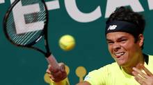 Milos Raonic and new doubles partner Bernard Tomic of Australia lost 6-3, 6-3 on Saturday in the semi-finals of the Monte Carlo Masters to the top-seeded Americans Bob and Mike Bryan. (file photo) (ERIC GAILLARD/REUTERS)