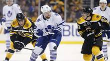 Boston Bruins' Torey Krug (47) and Milan Lucic (17) defend against Toronto Maple Leafs' Phil Kessel, center, in the first period of an NHL game in Boston, Saturday, Nov. 9, 2013. (AP)