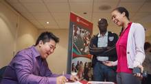 Leah Junor and her father Tony Junor register with Vince Kang, a peer mentor from the University of Ottawa, before an event for incoming students from the Toronto area in Mississauga. (JENNIFER ROBERTS For The Globe and Mail)