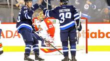 Winnipeg Jets defenceman Tobias Enstrom (39) celebrates with teammates after scoring a goal during the first period against the Florida Panthers at MTS Centre. (BRUCE FEDYCK/USA TODAY SPORTS)