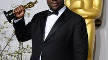 "Director Steve McQueen poses in the press room with the award for best picture for ""12 Years a Slave"" during the Oscars at the Dolby Theatre on Sunday, March 2, 2014, in Los Angeles. (Jordan Strauss/Invision/AP)"
