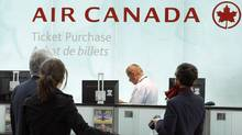 Air Canada passengers wait to purchase tickets at Toronto's Pearson airport in 2008. (MIKE CASSESE/Mike Cassese/Reuters)