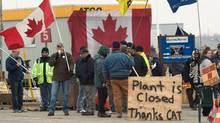 CAW members picket outside at the Electro-Motive plant in London, Ont., on Friday, feb. 3, 2012