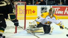 Sarnia Sting goalie JP Anderson awaits a shot by Seth Griffith of the London Knights during the second period of OHL action in London Ont., Tuesday, January 1, 2013. (Geoff Robins/THE CANADIAN PRESS)