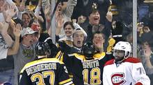 Fans celebrate with Boston Bruins right wing Reilly Smith (18) and center Patrice Bergeron (37) after Smith's goal during the third period in Game 2 of an NHL second-round playoff series against the Montreal Canadiens in Boston, Saturday, May 3, 2014. Canadiens defenceman P.K. Subban (76) skates near at right. The Bruins won 5-3. (Elise Amendola/AP Photo)