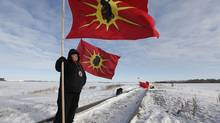 Idle No More demonstrators block a CN east-west track just west of Portage La Prairie, Manitoba. (JOHN WOODS/THE CANADIAN PRESS)