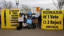 Veto supporters rally in front of the White House on the same day U.S. President Barack Obama vetoed a Republican bill approving the Keystone XL oil pipeline from Canada. (LARRY DOWNING/Reuters)